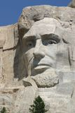 Abraham Lincoln. Mt. Rushmore in August with a beautiful blue sky in the background Stock Photography