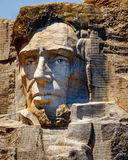 Abraham Lincoln carved on Mount Rushmore. Abraham Lincoln, the 16th president of the United States of America and responsible for the abolition of slavery, is stock image
