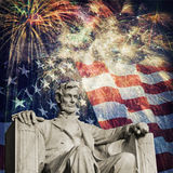 Abraham Lincoln Fireworks. Composite photo of the statue of Abraham Lincoln at the Lincoln Memorial with a flag and fireworks in the background. Nice patriotic royalty free stock photo