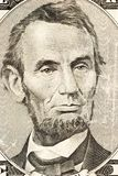 Abraham Lincoln on FIve. Abraham Lincoln's portrait on front of a five dollar bill stock photos