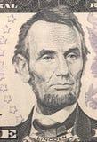 Abraham Lincoln-het gezicht op de dollars van de V.S. vijf of 5 factureert macro, het geldclose-up van Verenigde Staten stock foto