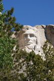 Abraham Lincoln looks out from his Mt Rushmore pos Stock Images