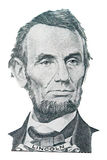 Abraham Lincoln portrait. Portrait of Abraham Lincoln in front of the five dollar bill stock photos