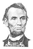 Abraham Lincoln portrait. Portrait of Abraham Lincoln in front of the five dollar bill royalty free stock photography