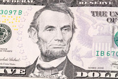 Abraham Lincoln. Portrait of Abraham Lincoln in front of the five dollar bill stock image