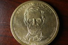 Abraham Lincoln Portrait on Gold Dollar Coin stock images