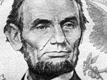 Abraham Lincoln portrait macro on 5 dollars money usa or american banknote stock photo