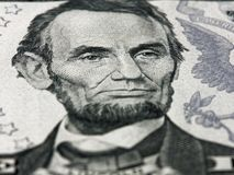Abraham Lincoln portrait macro on 5 dollars money usa american banknote. Abraham Lincoln portrait macro on 5 dollars money usa or american banknote stock photos