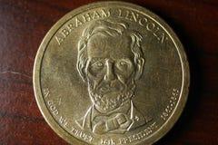 Abraham Lincoln Portrait op Gouden Dollarmuntstuk stock afbeeldingen