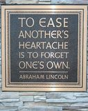 Abraham Lincoln Quote. Beautiful Quote Plaque written by Abraham Lincoln to remind us that heartache is best forgotten if give of ourselves stock photos