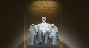 Abraham Lincoln. This is taken from inside the Lincoln Memorial, in Washington DC at night to provide a darker, more somber view than traditional daytime shots Royalty Free Stock Image