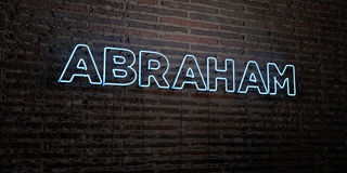 ABRAHAM -Realistic Neon Sign on Brick Wall background - 3D rendered royalty free stock image. Can be used for online banner ads and direct mailers Stock Image