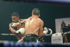 Abraham Roqueni of Spain and Expedito Valin of France in Thai Fight 2013. Royalty Free Stock Image