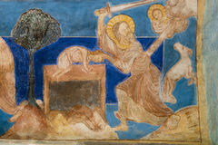 Abraham`s sacrifice. Romanesque wall-painting. Abraham puts his son Isaac on the altar and is about to kill him, but is prevented by an angel. Wall painting in royalty free stock photography