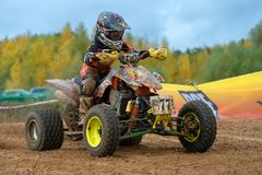 Abramov Nikolay 77. SERPUKHOV, RUSSIA - OCTOBER 7, 2017: Abramov Nikolay 77,  Class ATV-JUNIORS, in the 4 stage  MX series, the Red Wings Cup 2017 super country Royalty Free Stock Image
