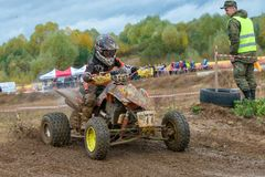 Abramov Nikolay 77. SERPUKHOV, RUSSIA - OCTOBER 7, 2017: Abramov Nikolay 77,  Class ATV-JUNIORS, in the 4 stage  MX series, the Red Wings Cup 2017 super country Royalty Free Stock Photography