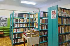 Abramovskaya village, Russia, Arkhangelsk region, Onega district, February,17, 2018. Building of the rural library stock photography