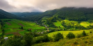 Abranka village in Carpathian mountains. Lovely rural scenery on a cloudy sunrise royalty free stock image