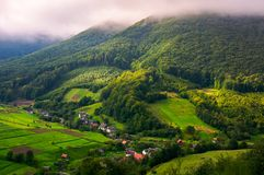 Abranka village in Carpathian mountains. Lovely rural scenery on a cloudy sunrise royalty free stock photography