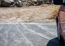 Abrasion on the asphalt road. Parking cars of mountain Stock Image