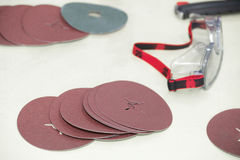 Abrasive discs and eyewear Royalty Free Stock Images