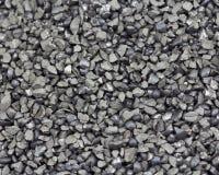 Abrasive grit. Macro photograph of abrasive steel grit Stock Photos