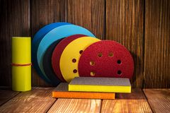 Abrasive rotary wheels set on vintage wood. Big set of abrasive tools on vintage wood background. The wizard is used for grinding items royalty free stock image