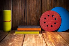 Abrasive rotary wheels set on vintage wood. Big set of abrasive tools on vintage wood background. The wizard is used for grinding items royalty free stock images