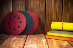 Abrasive rotary wheels set on vintage wood. Big set of abrasive tools on vintage wood background. The wizard is used for grinding items stock photos