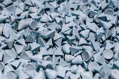 Abrasive stones for vibration grinding. Royalty Free Stock Images