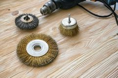 Abrasive tools for brushing wood and giving it texture. Wire brushes on treated wood. Copy space royalty free stock photography