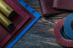 Abrasive  tools sand paper and abrasive wheels on vintage wood stock images