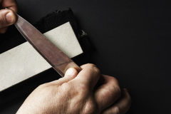 The abrasive which sharpen the knife. The abrasive in which hand-sharpened knife Stock Image