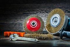 Abrasive wire tools set on vintage wood background stock image