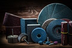 Abrasives on vintage wood background stock photography