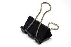 Abrazadera de papel aislada en el fondo blanco Imagen de archivo libre de regalías