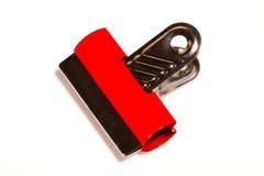 Abrazadera de papel roja Imagen de archivo