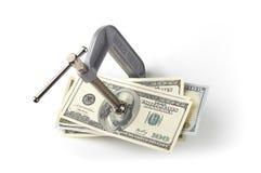 Abrazadera que exprime el dinero Foto de archivo libre de regalías