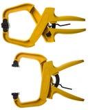 Abrazaderas amarillas Imagen de archivo libre de regalías