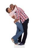 Abrazo afroamericano de los pares Foto de archivo libre de regalías