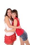 Abrazo de dos adolescentes Imágenes de archivo libres de regalías