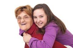 Abrazo de la abuela y de la nieta Imagenes de archivo