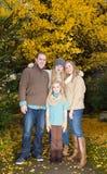 Abrazo de la familia en el parque Fotografía de archivo libre de regalías