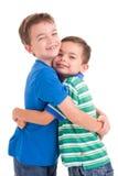 Abrazo de los cabritos Foto de archivo libre de regalías