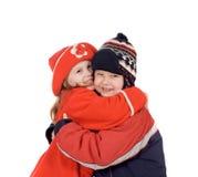 Abrazo de los niños fotografía de archivo libre de regalías
