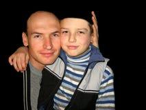 Abrazo del padre y del hijo foto de archivo