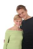 Abrazo joven feliz de los pares Fotografía de archivo libre de regalías