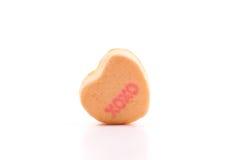 Abrazos y besos en el caramelo del corazón Imagenes de archivo
