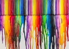 Abrégé sur coloré fondu crayons Photos libres de droits