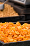 Abricots for sale. Beautiful stack of yellow and orange abricots for sale in a market stall in Breda, The Netherlands on a traditional season market Royalty Free Stock Photography